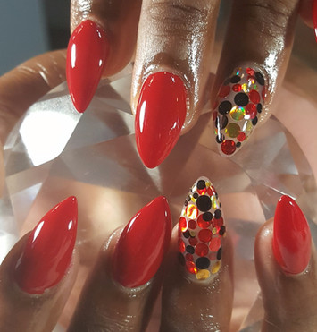 Almond shaped acylics with red polish & embedded dots!