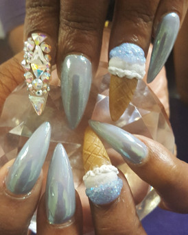 Long stilletto nails with chrome accents, swarovski crystals and 3D acrylic art.