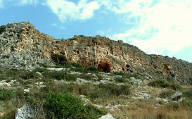 1200px-Misliya_cave_in_Megadim_Cliff,_Mo