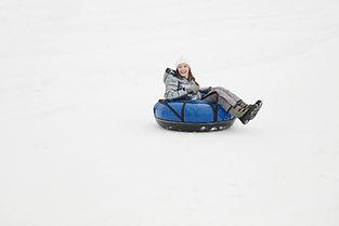 Woman Snow Tubing