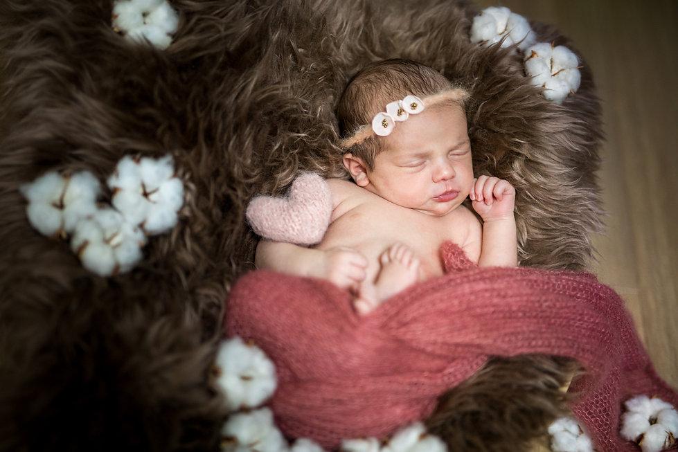 Photographe nouveau-né poing