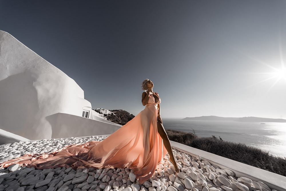 Photoshoot with long flying dress in Santorini