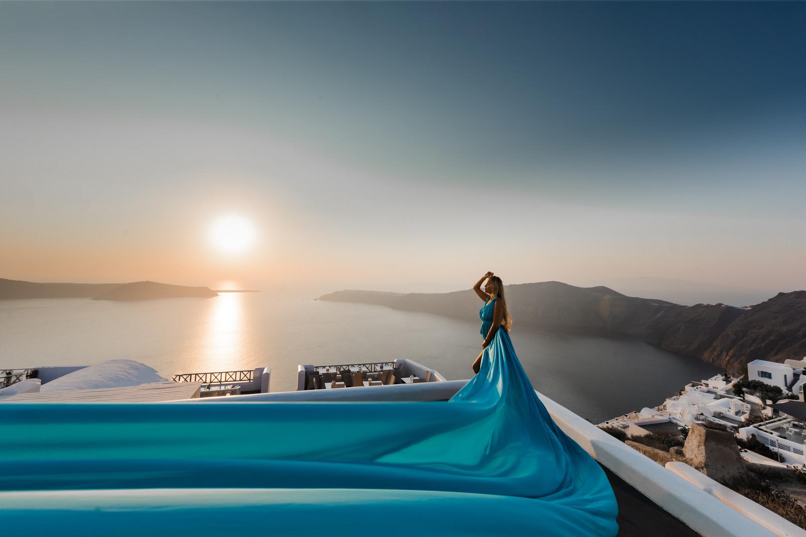 Photographer in Santorini, long flying dress