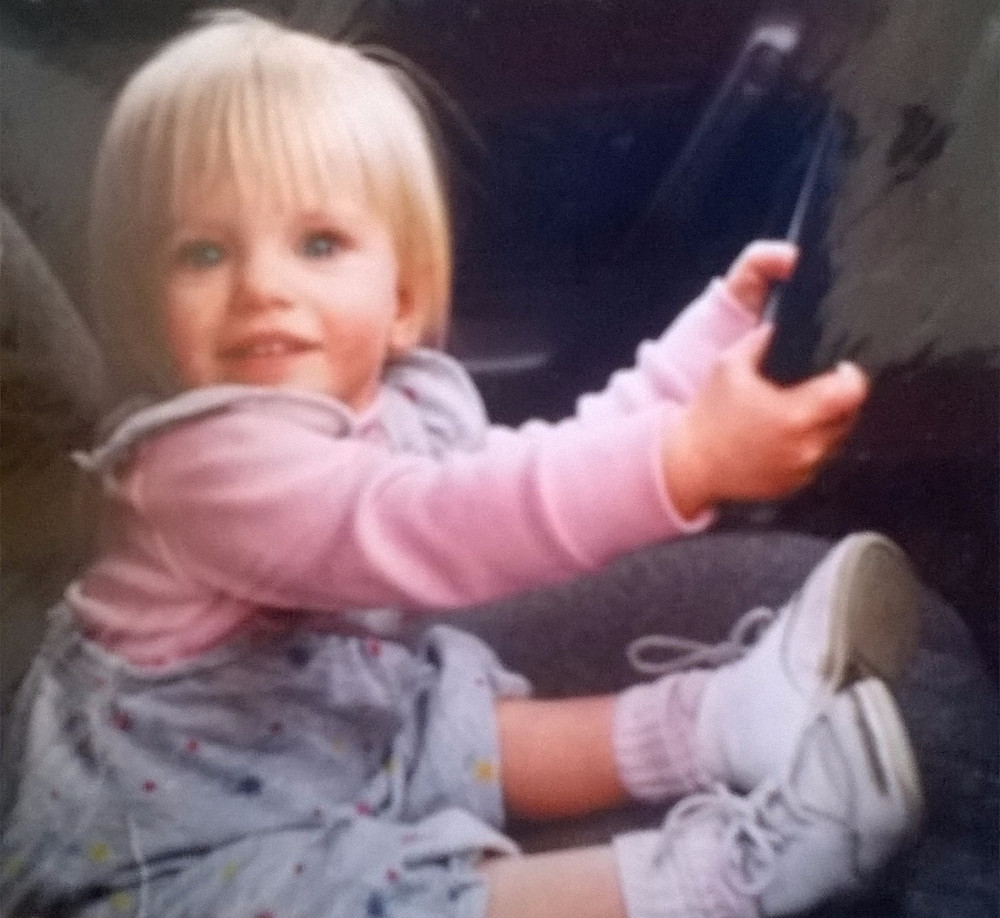 Aly as a toddler, ready to drive already!   VOICE Birth Options