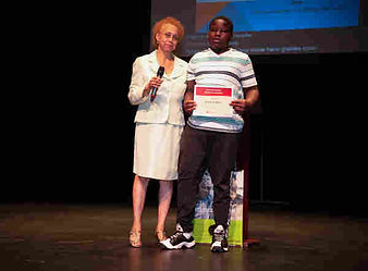African American adult female standing next to African American young male.