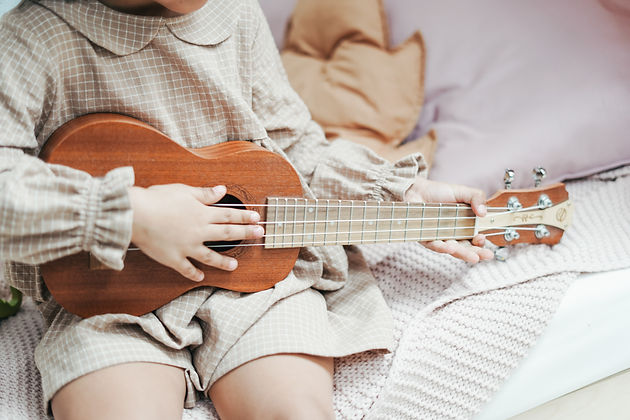 Copy of a-girl-holding-brown-ukulele-366