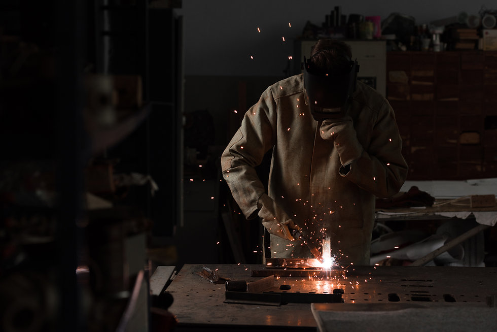 worker-in-protection-mask-welding-metal-at-factory-HCVQRJG.jpg