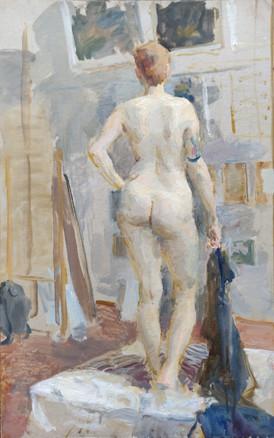 Female standing nude in the studio