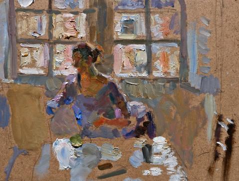 Vera working against a window