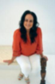 Carla Orange HeadShot.jpg