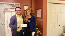PennyPosh's Dani Ryan presents the Autism Society with a check on Giving Tuesday!