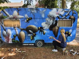 Caravan with bees and flowers
