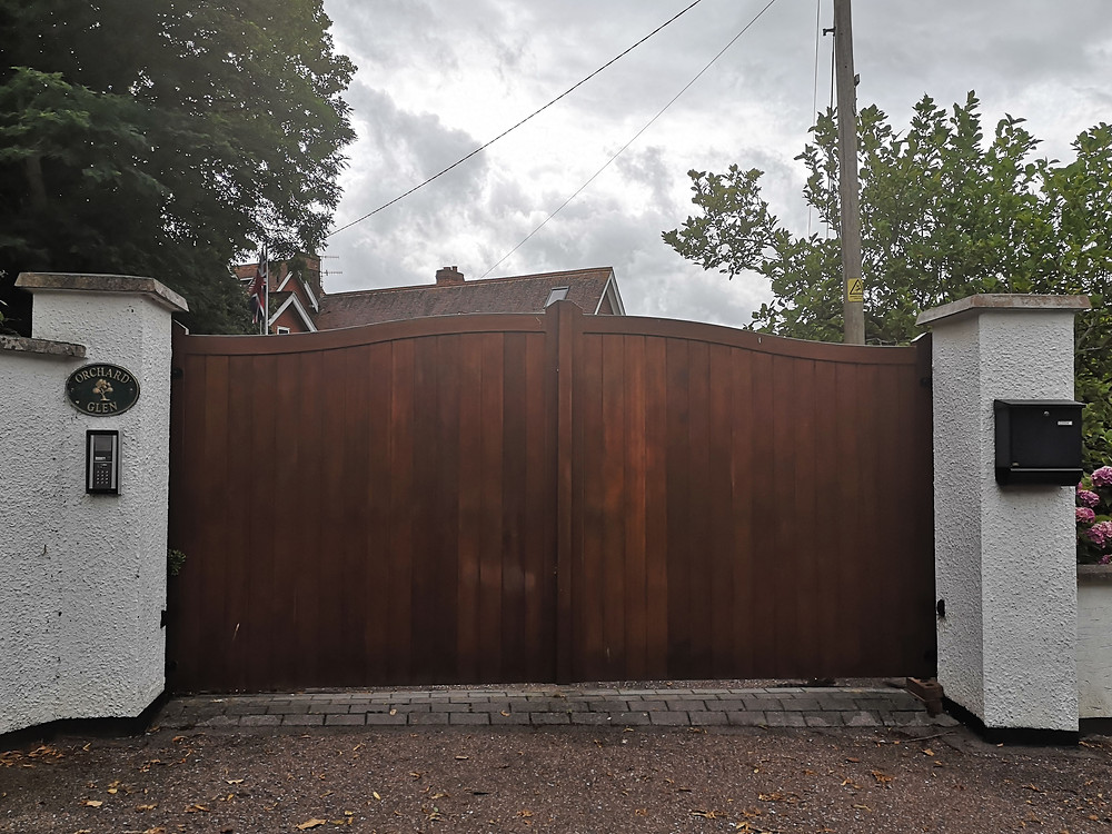 Large front gates with security to bar access to private interior, signage for orchard glen
