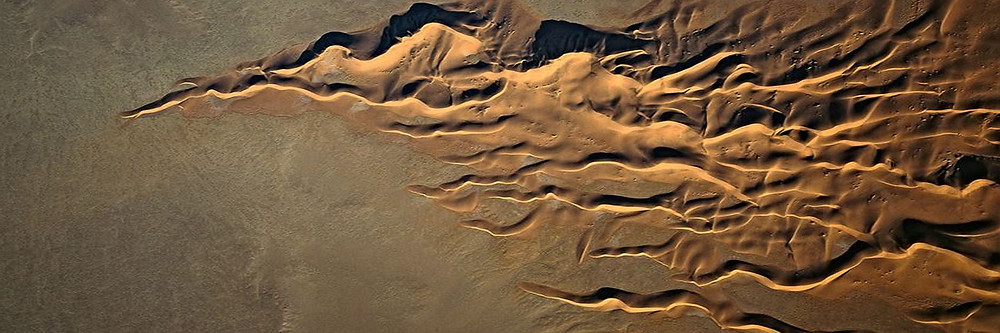 Aerial photo of Namibian sand dunes, replicating and fanning out