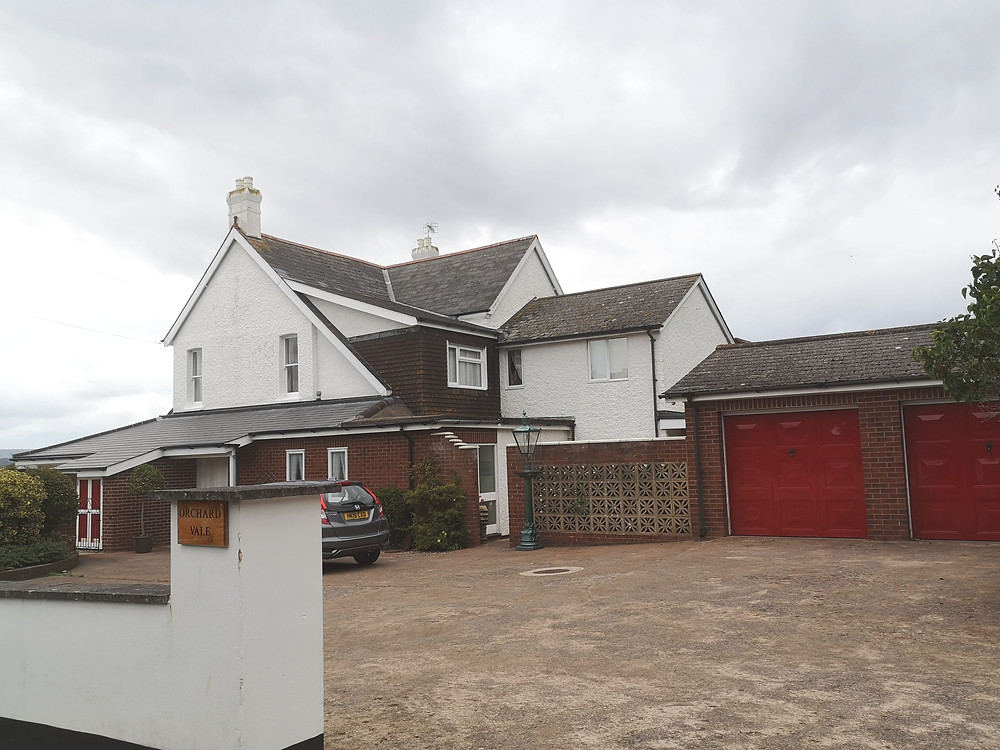 Detached house with large paved turning area at front signed orchard vale