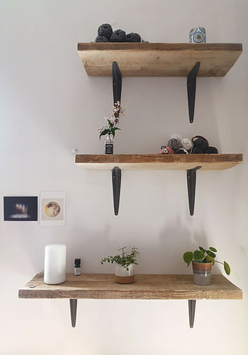 reclaimed scaffold board shelves, handbuilt with a selection of crochet cottons, plants, muji diffuser, artwork and creativity
