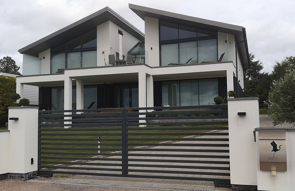 sea view house with large glazing and fancy front gates for security