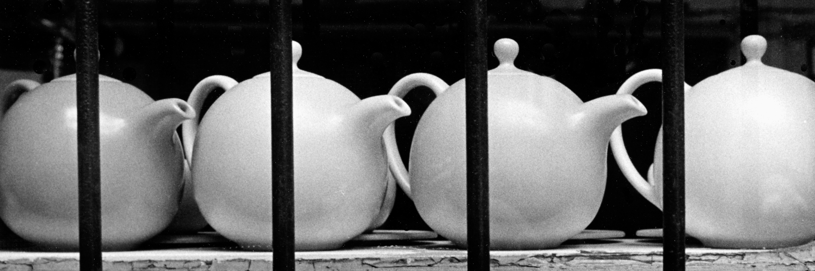 Tea Pots In Window.