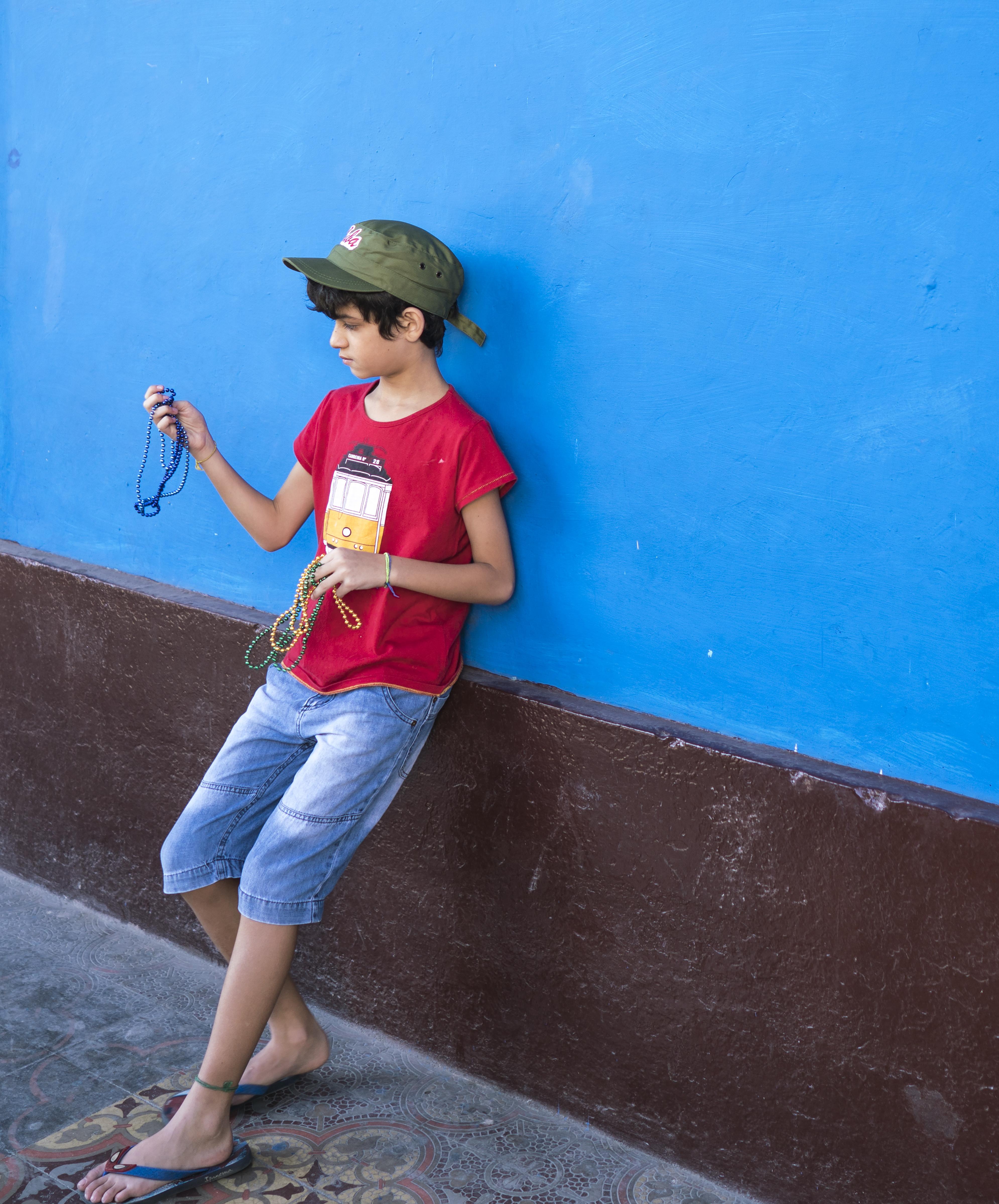 Boy on Blue Wall copy