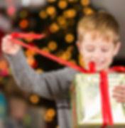 istock Young boy opening Christmas gift.