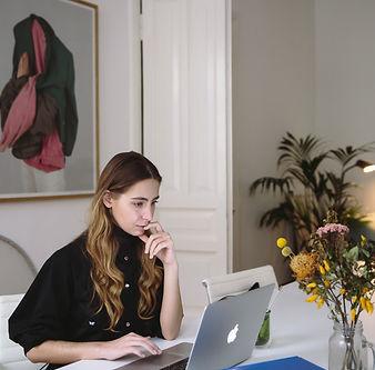 woman watching at laptop.jpg