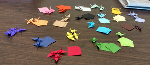 I am folding them in batches of 80: four small squares of each of the 20 colors.