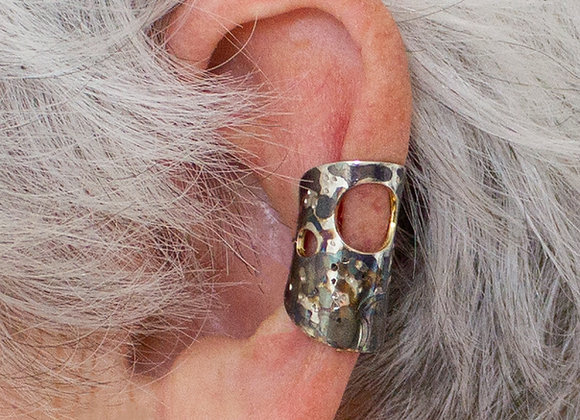 Silver ear cuffs with a coloured patina