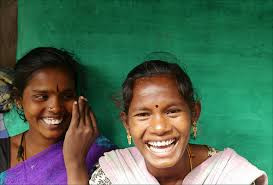 two young women laughing about how funny their husbands are
