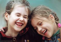 two girls laughing at a funny joke
