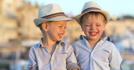 twin brothers laughing because one of them burped