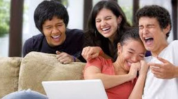 four young people watching Friends on their laptop