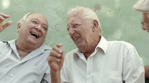 three old friends sharing funny stories about their past