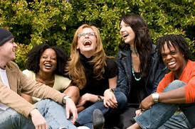 five university friends laughing about how easy their last exam was