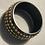 Thumbnail: Bracciale resina nero mini borchie bronzo