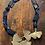 Thumbnail: Collana pietre dure nere ciondolo ottone