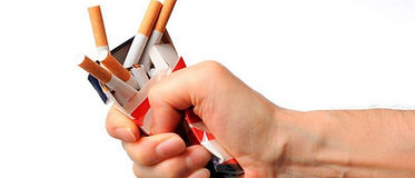 Isolated-shot-of-broken-cigarettes-on-wh