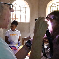 Say aaahh! A young girl gets her first physical at a HHP mobile clinic in the mountain town of Mapou.