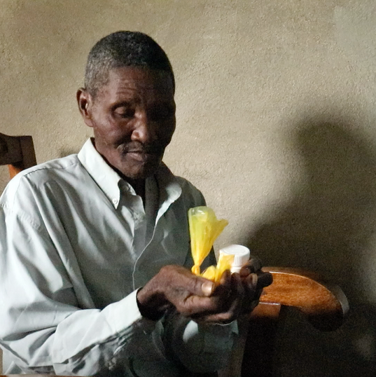 A mobile clinic patient in the southeast mountain town of Mapou gets medications provided free to HHP by its partner Americares.