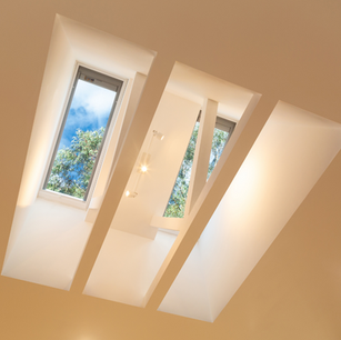 Feature skylight bay with wrapped trusses and lighting installed at Woodford