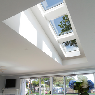 A bank of three Velux skylights with blinds installed on a flat roof at Lane Cove