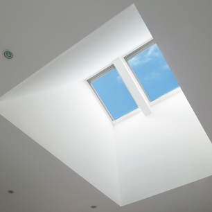 Double skylight with splayed shaft installed into re-engineered truss roof at Cranebrook