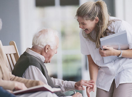 Laughing lady with elderly man