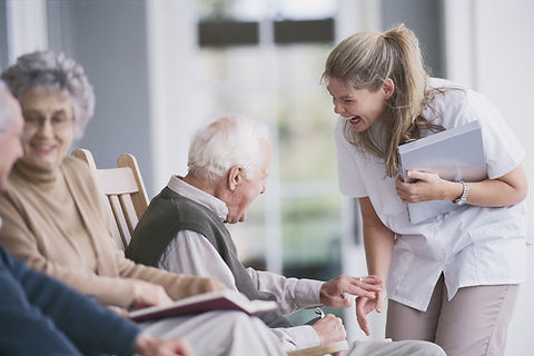 Seniors Socializing with Assisted Living Residents and Caregivers
