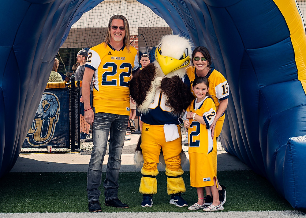 Owners of the Magnolia Salon and Spa cheer on Eagles at Reinhardt University | Photo credit: hamervisuals.com