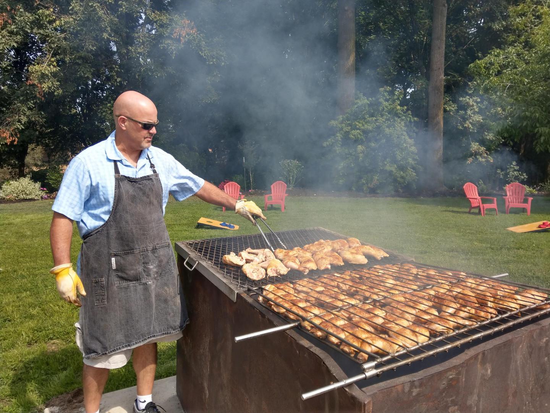 Reg running the grill