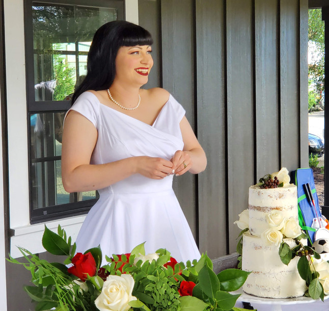 The bride cutting cake from The Kitchen deck