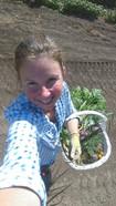 Lora picking veggies