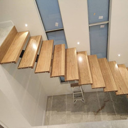 Black stair treads by Go Natural Timbers