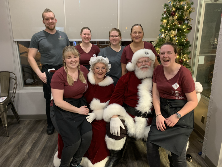 Staff Pic with Santa and Mrs Claus