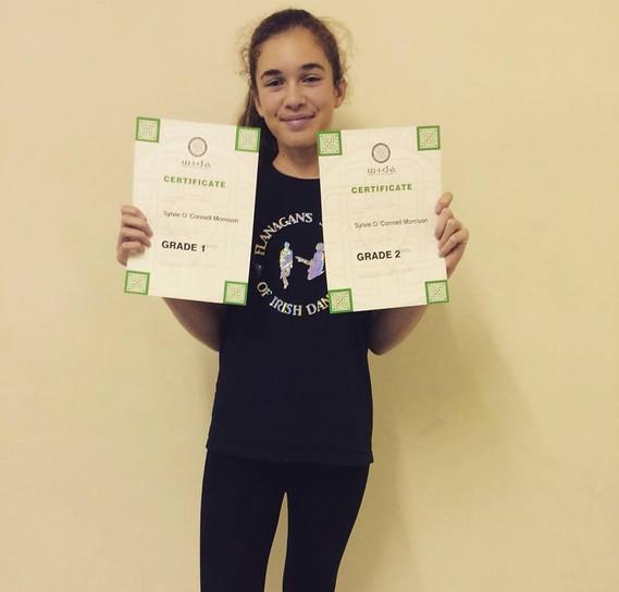 Our Sylvie with her grade certificates